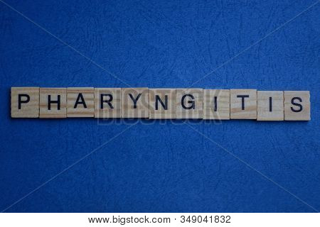 Gray Word Pharyngitis From Small Wooden Letters On A Blue Table