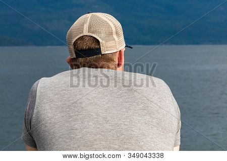 Close Up Shot From Behind Of The Young Man, Passenger Of A Ferryboat Navigating In A Canadian Lake.