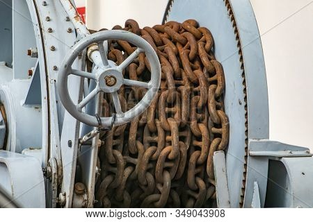 Old, Rusty Brown Chain On A Passenger Ferryboat Navigating In A Canadian Lake. Probably Anchor Chain