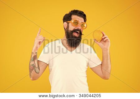 Genius Orange Inspiration. Genius Man With Orange Pointing Finger Up On Yellow Background. Bearded H