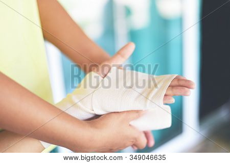 Hand Wound Bandaging Arm By Nurse / First Aid Wrist Injury Health Care And Medicine Concept