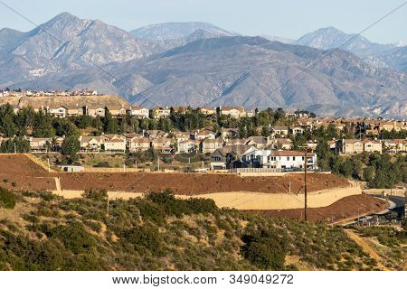 Hilltop houses overlooking the San Fernando Valley in Los Angeles, California.  The San Gabriel Mountains are in the background.