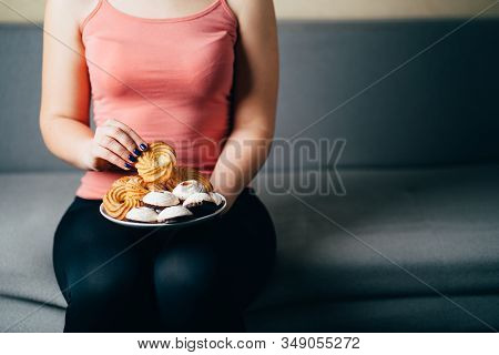 Unhealthy Snack, Excess Calories, Sugar Addiction, Nutrition Value. Fit Woman Snacking With Sugary F