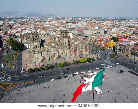 Mexico National Flag On Zocalo Constitution Square And Metropolitan Cathedral Aerial View, Mexico Ci