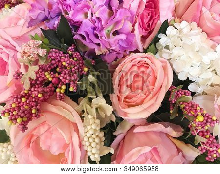 Top View Of Sweet Artificial Or Synthetic Decorated Flower For Background And Texture