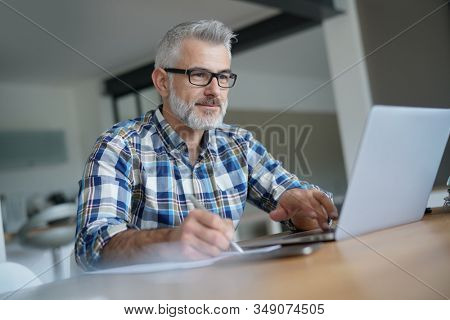 Man working from home on laptop computer