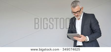 Businessman using digital tablet isolated on background- template