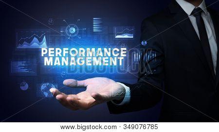 Hand of Businessman holding PERFORMANCE MANAGEMENT inscription, business success concept