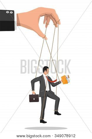 Businessman Marionette Is Hanging On Ropes. Hand Of Puppeteer Holding Business Man On Leash. Puppet