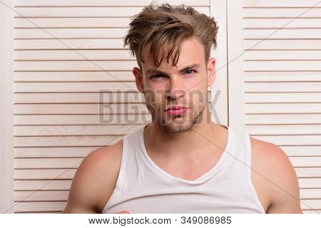 Guy With Unshaved Face On Background Of Beige Jalousie