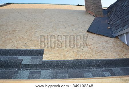 Roofing Construction With Asphalt Shingles Installation In House Rooftop Attic  Corner Problem Area.