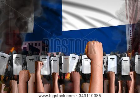 Protest In Finland - Police Officers Stand Against The Protesting Crowd On Flag Background, Revolt F