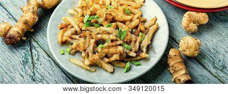 Fried Jerusalem Artichoke On Plate