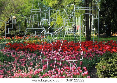Kiev, Ukraine - April 26, 2018: Silhouette Of A Decorative Couple In Love In A City Park Or Garden.