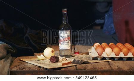 Exhibit Of Old Peasant Table With Vodka, Sausage, Onion, Eggs And Other Things Showing In The Museum