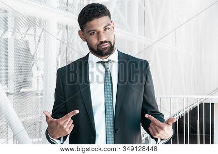 Confident Black Business Man Pointing At Himself. Serious Guy Looking At Camera And Standing With Bu