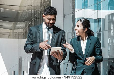 Happy Business People Talking And Walking Along Street. Business Man And Woman Wearing Formal Clothe