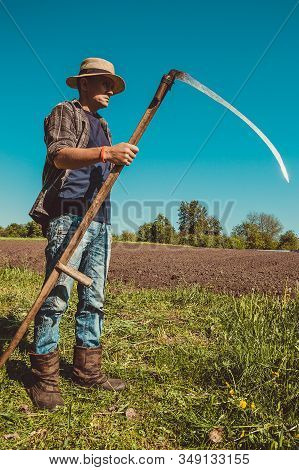 Authentic Rural Farmer With Scythe. Agriculture Worker. Sharp Blade. Vegetable Garden. Farm Implemen