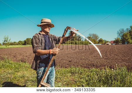 Authentic Rural Farmer Check Sharpness Scythe. Agriculture Worker. Vegetable Garden. Farm Implements
