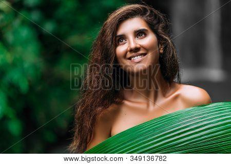Portrait Of A Beautiful Smiling Girl. Portrait Of A Girl With A Green Leaf. Portrait Of A Girl In Cl