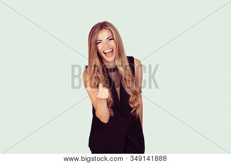 Portrait Of A Beautiful Woman Laughing Ecstatic Pointing At You Isolated On Light Green Background W