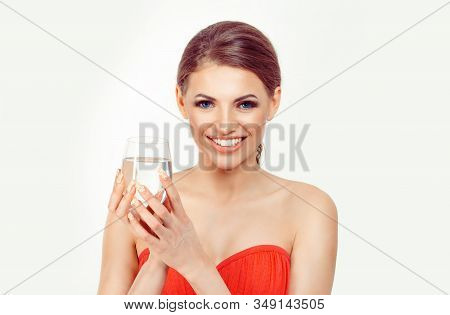 Hydrate Yourself. Young Happy Smiling Woman Holds A Glass Of Water In Her Right Hand. White Backgrou
