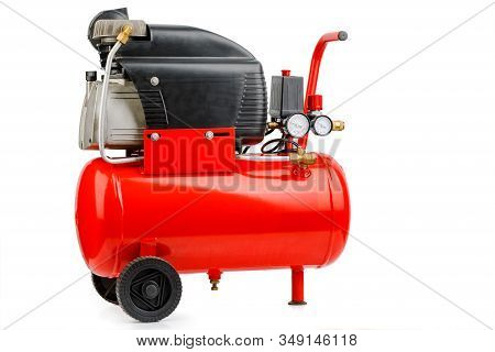Air Compressor. An External Compressor. Industrial Compressor In Red On A White Background.