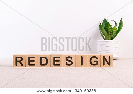 Redesign Word Made With Building Blocks On A Light Background