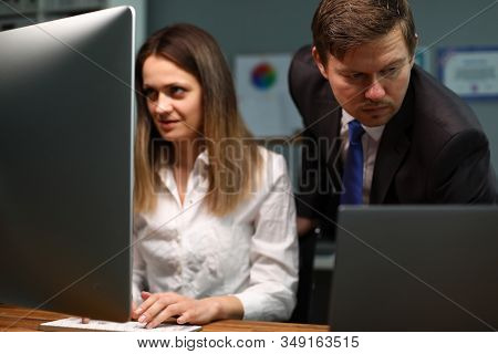 Employees Work Hard At Computers, Solving Problem. Colleague Studies His Duties Thoroughly. Verifica