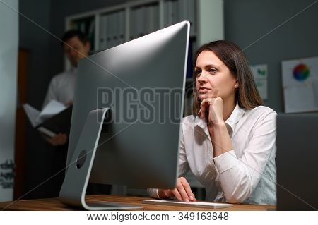 Woman In Office And Does Monotonous Job Computer. Distribution Documentation By Department. Control