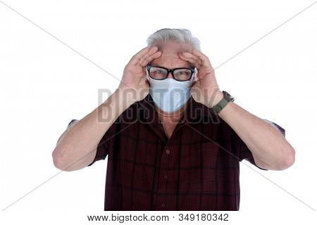 Coronavirus. 2019 Novel Coronavirus (2019-nCoV), Wuhan, China. A man with a paper face mask is worried about the Coronavirus . Isolated on white. Room for text. Clipping Path.  Coronavirus danger