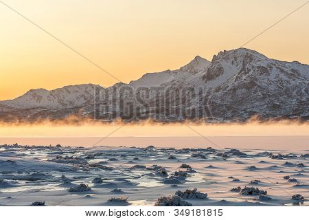 Dramatic Sunrise With Fog Over Lofoten Islands, Norway. Amazing Dramatic Sunset Over Lofoten Islands
