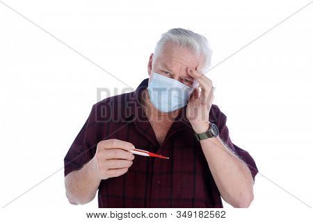 Coronavirus. 2019 Novel Coronavirus (2019-nCoV), Wuhan, China. A man with Coronavirus reads his temperature on a thermometer. Isolated on white. Room for text. Clipping Path.