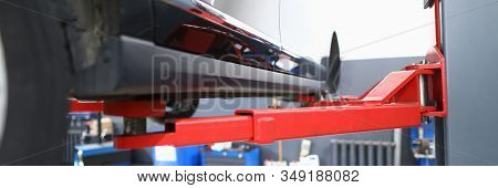 Close-up Of Colored Pillar Used For Automobiles And Sportcars Examinations And Lifting Heavy Machine