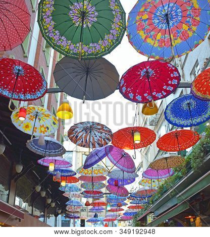 Colourful Umbrellas Hang From The Sky Covering A Street In The Moda District Of Kadikoy On The Asian