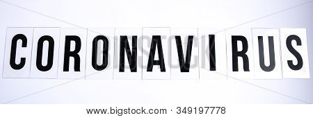 Banner The Word Coronavirus On A White Background, Copy Space, New Rapidly Spreading Virus From Chin