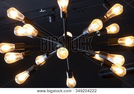 Lots Of Light Bulbs On A Dark Background.