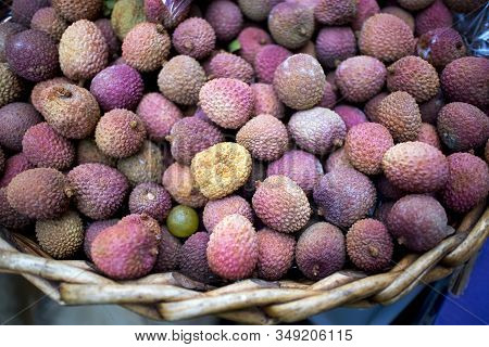 Pink Lychee In A Willow Wicker Basket For Sale On A Counter In Borough Market