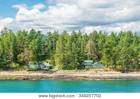 A perfect neighbourhood. Houses in suburb at Summer in the north America. Luxury houses with nice waterfront.