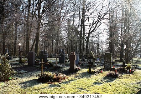 Sun Rays Glowing In Graveyard During Sunset