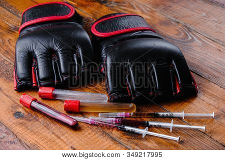 Mma Gloves And Steroid Medication Composition On A Wooden Background