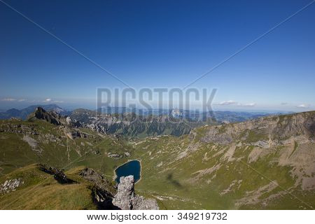 View Over A Valley In The Swiss Mountains On A Cloudless Day