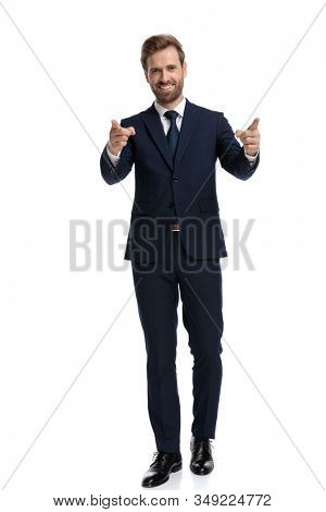 enthusiastic businessman smiling and pointing fingers, walking isolated on white background, full body