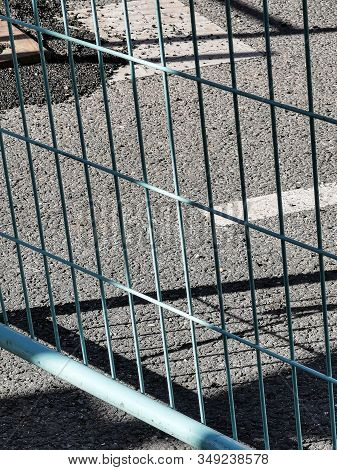 Closeup View Of Protective And Safety Construction Site Barrier On The Street.