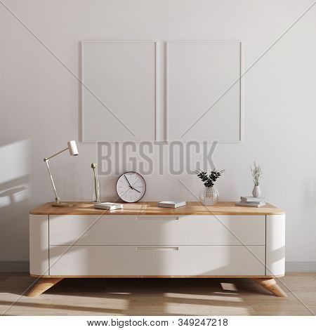 Poster Frames Mockup In Modern Interior Background. Empty Frames Above White Chest Of Drawers With B