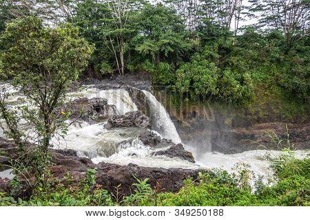 Hilo, Hawaii, Usa. - January 14, 2020: White Water Falling Over Lava Rocks On Edge Of Rainbow Falls.