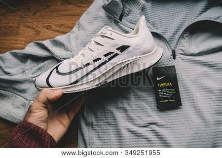 Paris, France - Sep 23, 2019: Pov Man Hand Holding Nike Zoom Rival Fly Professional Running Shoes Fo