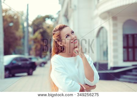 Daydream. Happy Woman Smiling Looking Up At Copy Space Above Hand, Thinking, Daydreaming Hand On Che