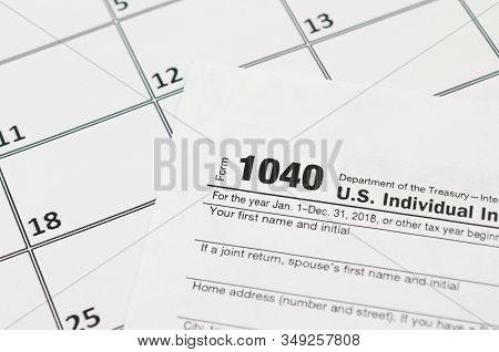 Irs Form 1040 Individual Income Tax Return Blank Lies On Empty Calendar Page