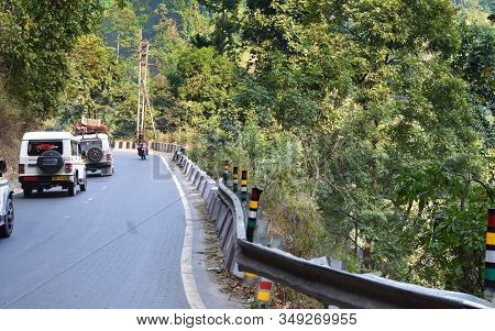 Darjeeling, West Bengal, India- December 25, 2019: Cars On A Mountain Road With A Very Acute Inner A